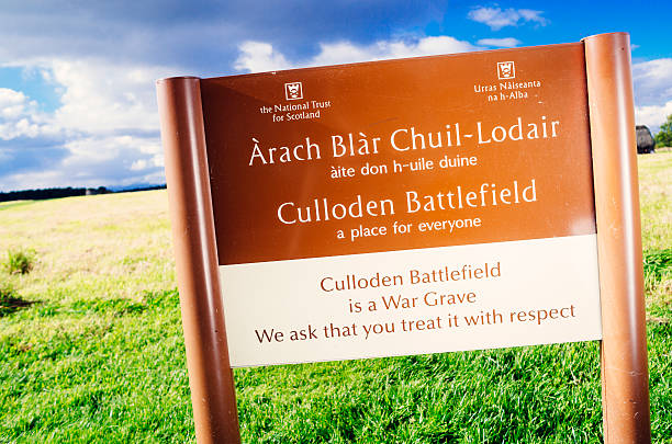 Culloden Battlefield sign Culloden, United Kingdom - October 04, 2014: Sign at the entrance to Culloden Battlefield outside Inverness in Northern Scotland. Fought in April 1746 between the French backed Jacobites led by Bonnie Prince Charlie, and the English led by the Duke of Cumberland, it is the site of the last pitched battle fought on British soil. The site, known as Drumossie Muir,  is administered by the National Trust for Scotland and covers an area of about 40 hectares of almost flat heathland, fairly dry today though considerably more boggy centuries ago. culloden stock pictures, royalty-free photos & images