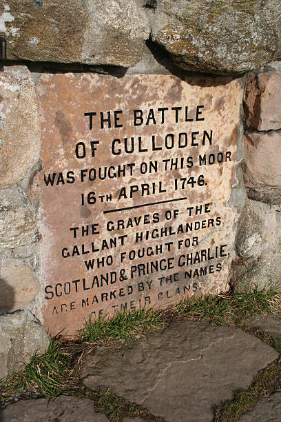 Culloden Monument Inscription Culloden battlefield Monument inscription. culloden stock pictures, royalty-free photos & images