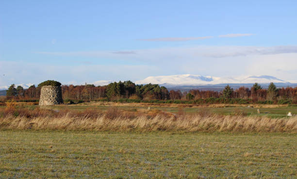 Culloden Moor with Winter Mountains and Cairn View of Culloden Moor, memorial Cairn or grave for the clans and snow capped mountains in the background in an autumn or early winter`s day. culloden stock pictures, royalty-free photos & images