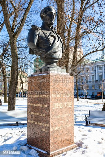 Saint Petersburg, Russia - March 18, 2018: sculpture of Mikhail Lermontov in Alexander Garden in Saint Petersburg city in sunny March day. The bust was installed in the 1890s