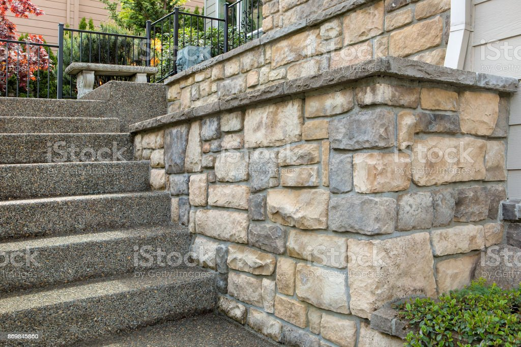 Cultured stone work on front of house in suburban residential neighborhood stock photo