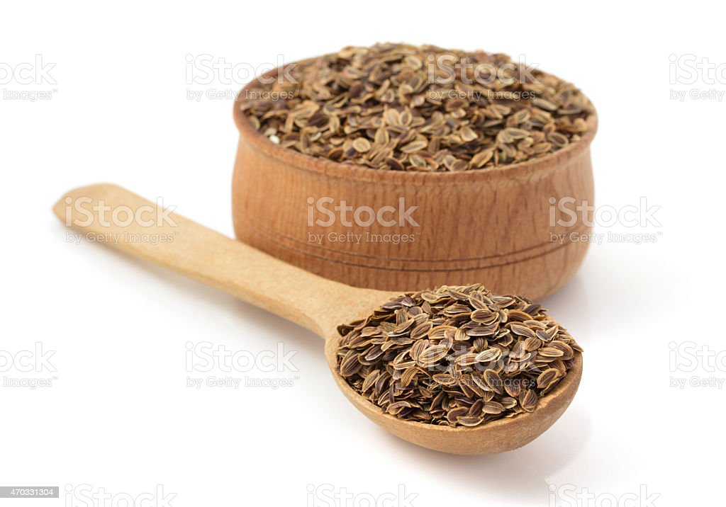 cumin seeds in bowl on white background stock photo