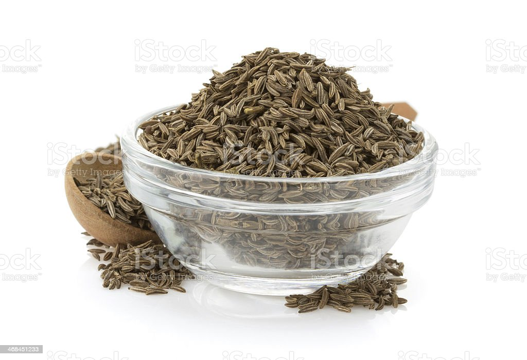 cumin seeds in bowl stock photo