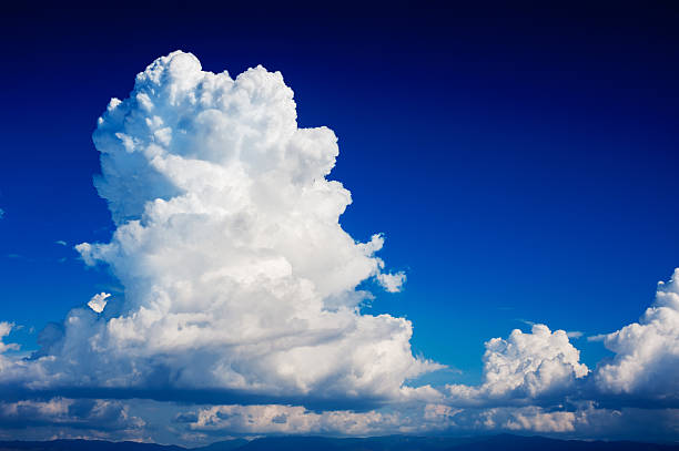 cumulonimbus cloud in a deep blue sky stock photo