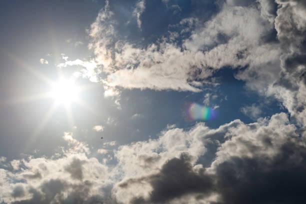 Cumulonimbus Clouds and Starburst Sun with Lens Flare stock photo