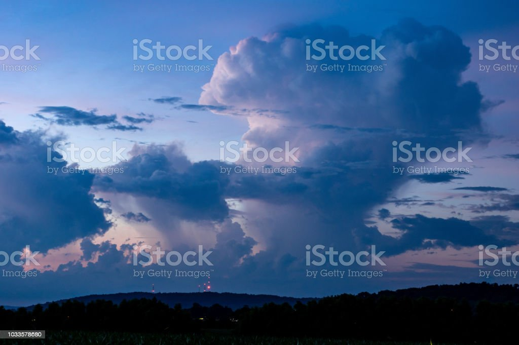 Cumulonimbus Clouds Reflecting the Last Glows of the Sun stock photo