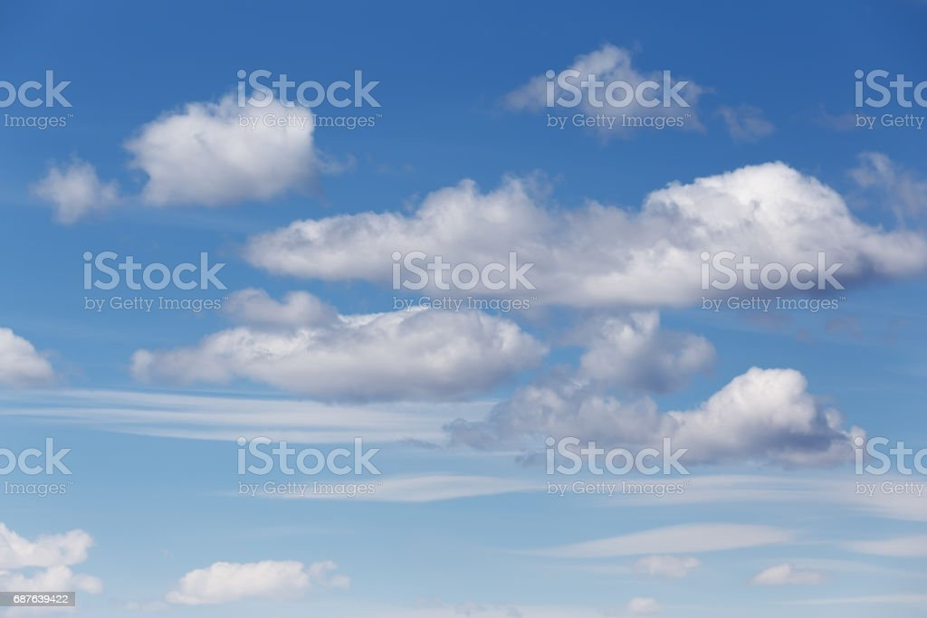 Cumulus and cirrus clouds stock photo