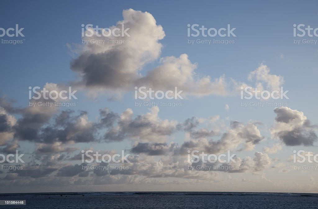 Cumulus Clouds above South Pacific Ocean at Sunset royalty-free stock photo