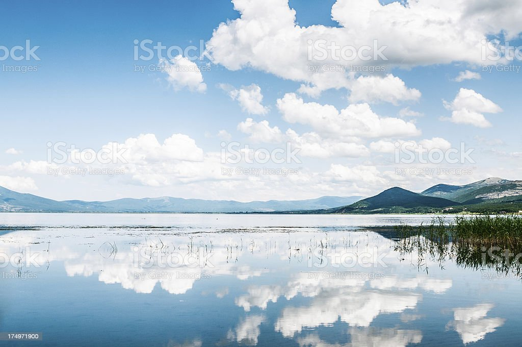 Cumulus Clouds and Reflection in the Lake stock photo