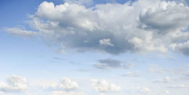 Cumulus Clouds in a Blue Sky stock photo