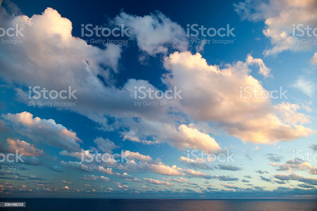 Cumulus Clouds at Sunset stock photo