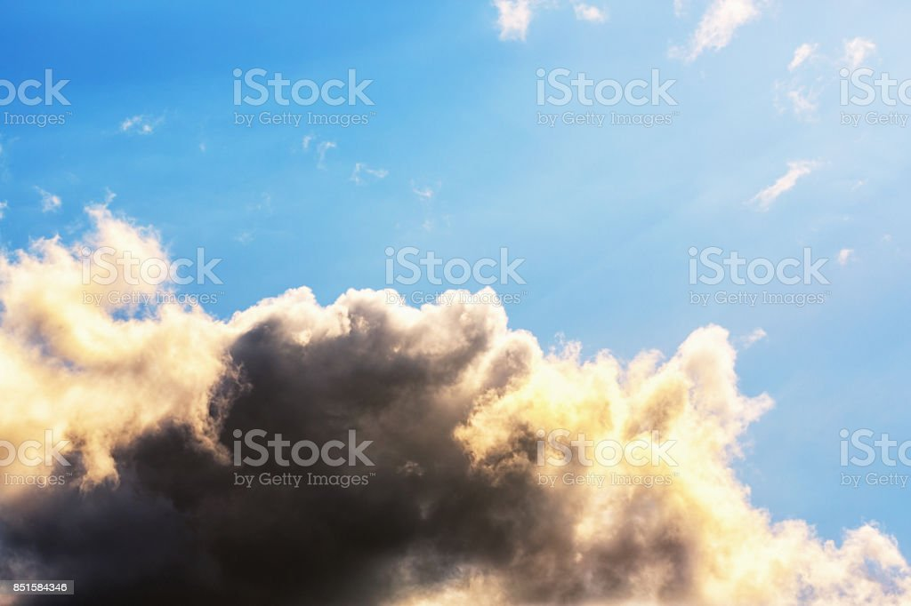 Cumulus clouds beautifully lit up by the sun stock photo