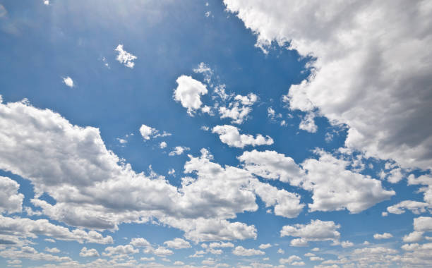 Cumulus Clouds in a Blue Sky Cumulus clouds appear in a blue sky over Rodgers Lake near Flagstaff, Arizona, USA. jeff goulden stock pictures, royalty-free photos & images
