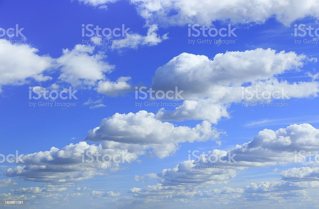 Cumulus clouds in blue sky royalty-free stock photo