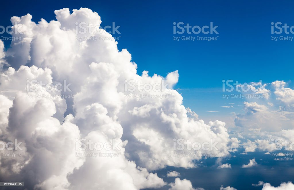 Cumulus clouds-eye level seen from an airplane stock photo