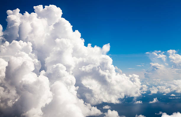cumulus clouds-eye level seen from an airplane - cloudscape stock photos and pictures
