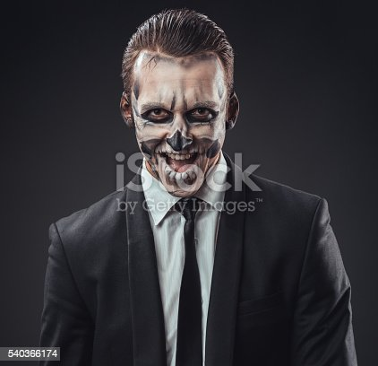 cunning businessman with a make-up of the skeleton