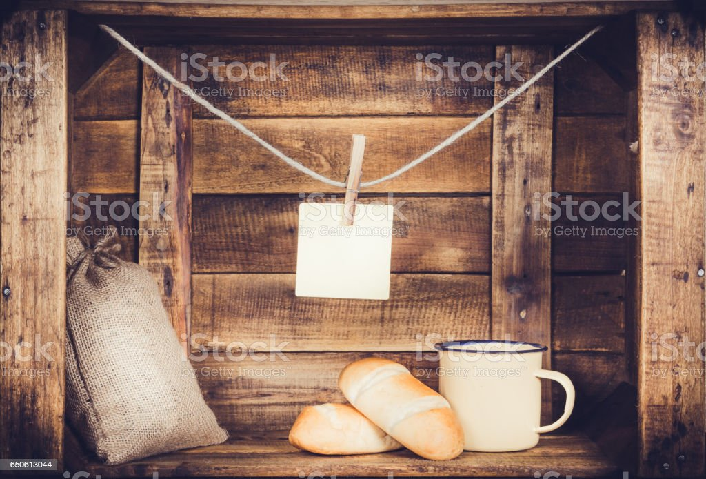 Cup and burlap with coffee bean sack and bread and post it one on wooden window-shaped box stock photo