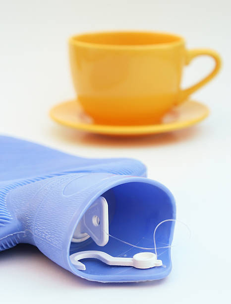 Cup and hot water bottle  affective stock pictures, royalty-free photos & images