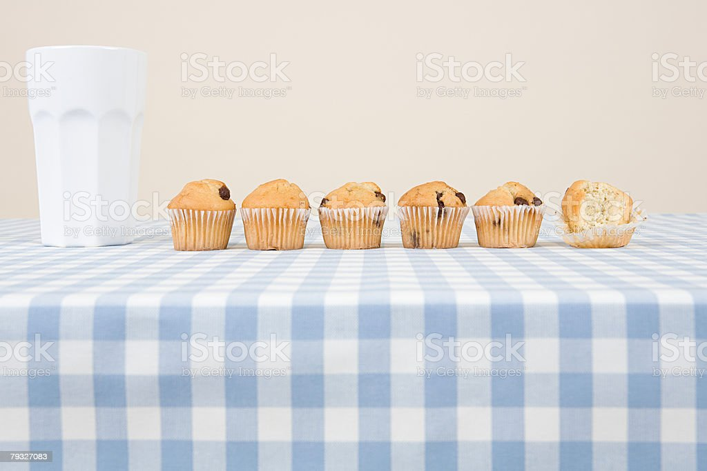 A cup and muffins in a row royalty-free 스톡 사진