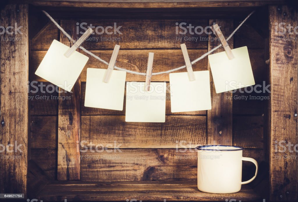 Cup and post it five on wooden window-shaped box stock photo
