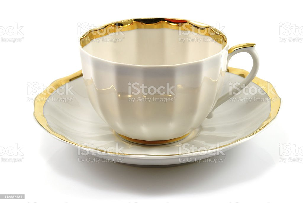 cup and saucer with gold trim royalty-free stock photo