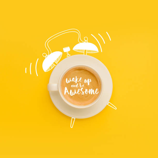 cup as ringing alarm clock - alarm clock stock photos and pictures