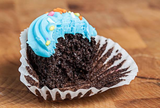 cup cake bitten - cravings bildbanksfoton och bilder