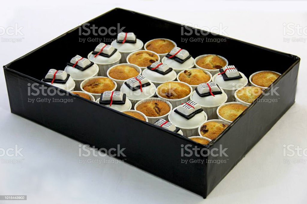 cup cakes muffin fondant book white background 1 stock photo