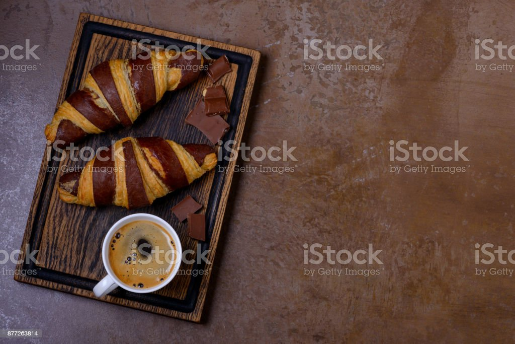 Cup coffee and chocolate croissant stock photo