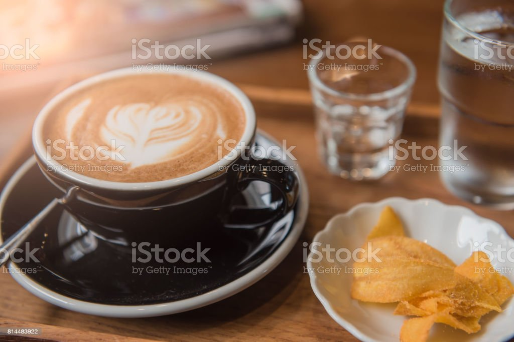 Cup coffee and set food and drink on wooden table in coffee shop at...