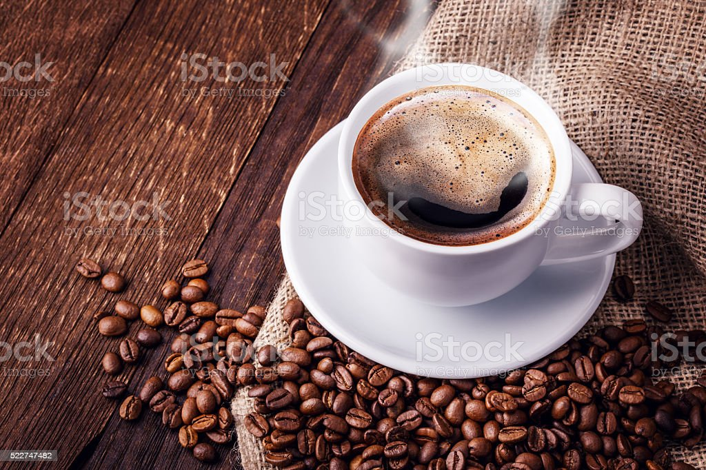 Cup coffee beans wooden stock photo