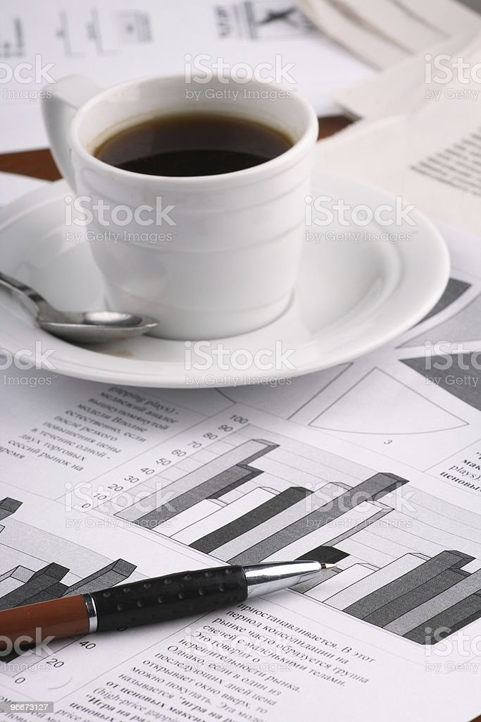 Cup coffee on business news royalty-free stock photo