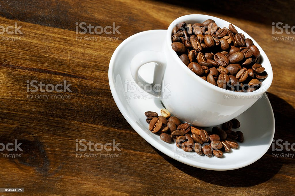 cup filled with roasted coffee beans royalty-free stock photo