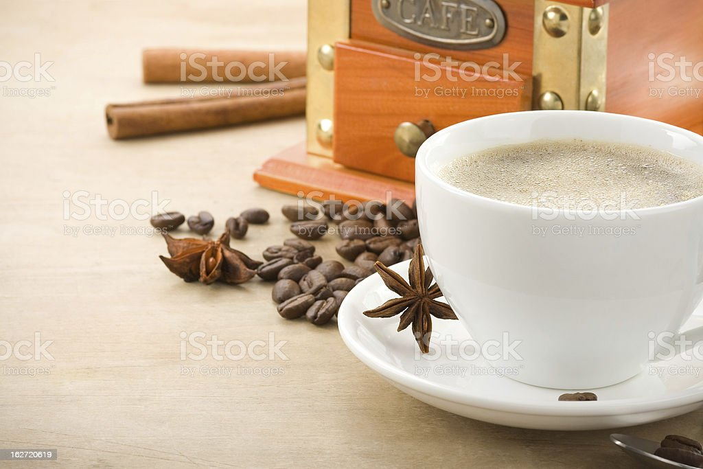 cup full of coffee drink on roasted beans at wood royalty-free stock photo