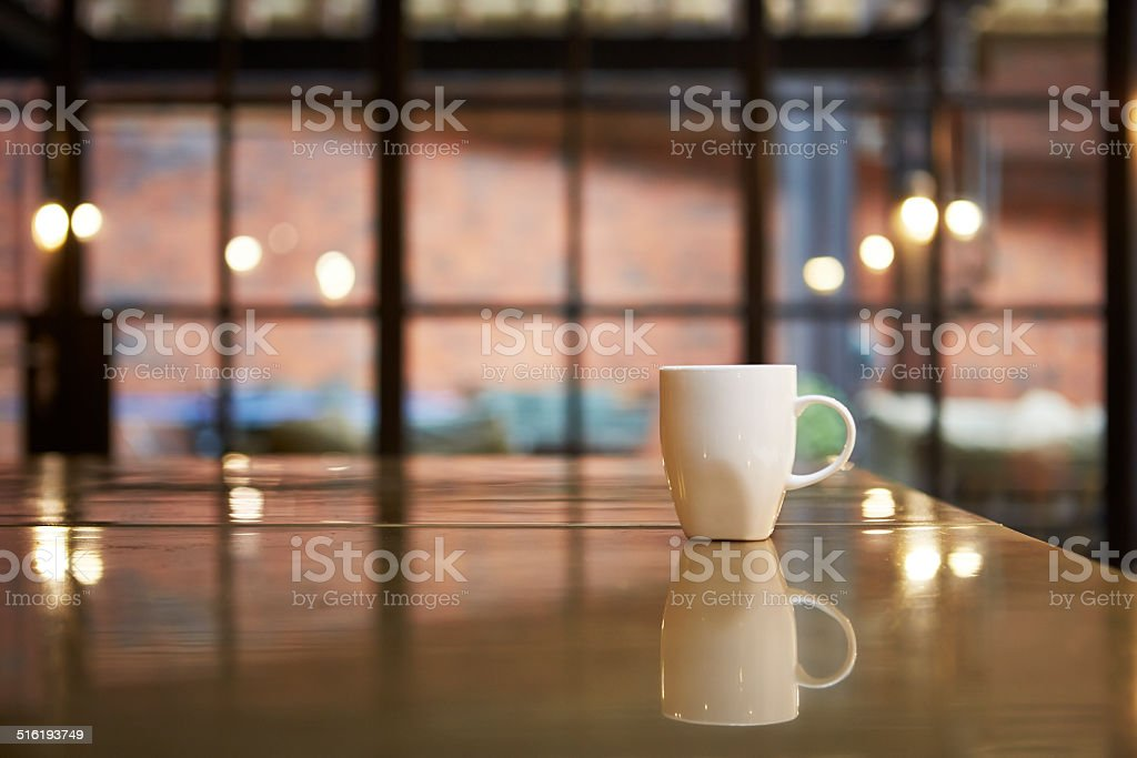 Cup in isolation on counter stock photo