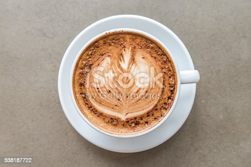 Cup of art latte on a cappuccino coffee on top view