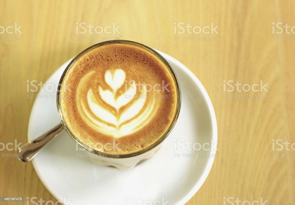 Cup of art latte or cappuccino coffee royalty-free stock photo