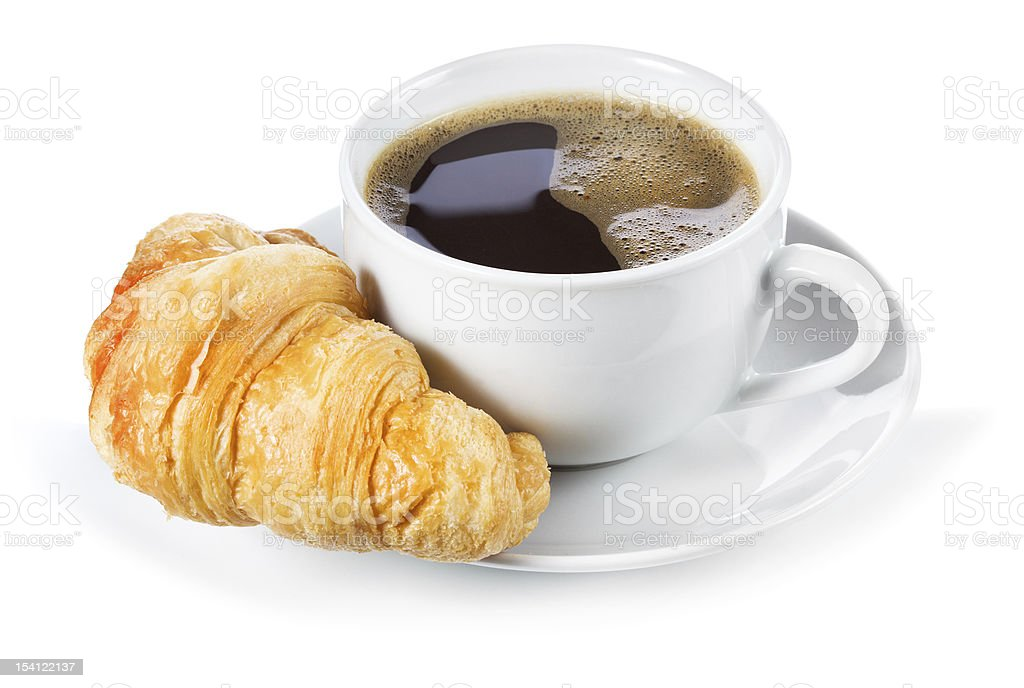 Cup of black coffee and croissant stock photo