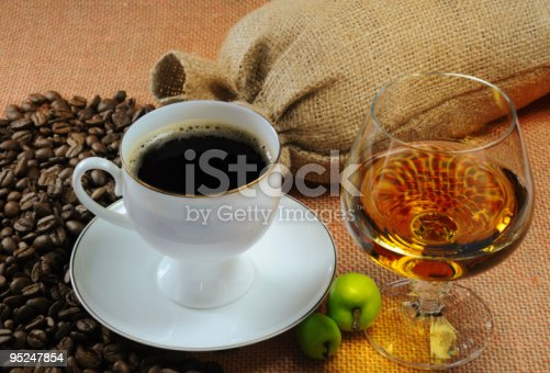 istock Cup of black coffee and saucer, and glass of alcohol 95247854