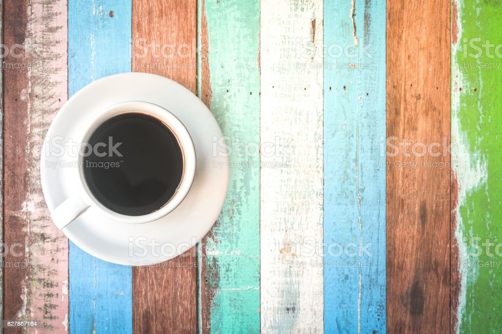 Cup of Black Coffee in White Cup on Wooden Tabletop. stock photo