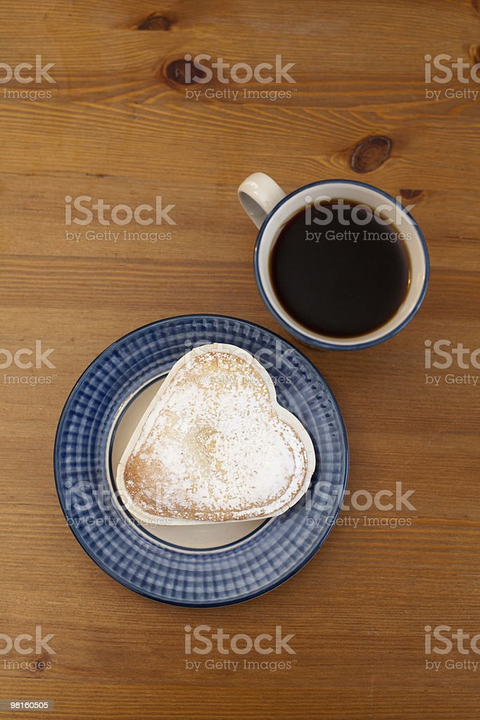 cup of black coffee with a heart shaped bun royalty-free stock photo