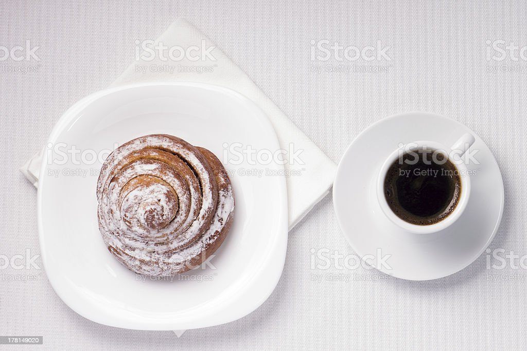 Cup of Black Coffee with a Sweet Bun stock photo