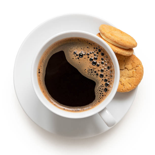 Cup of black coffee with biscuits. Cup of black coffee and crunchy cream oat biscuits with vanilla filling. Top view. black coffee stock pictures, royalty-free photos & images