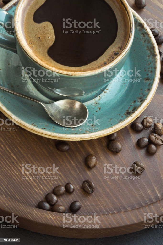 Cup of black coffee with coffee beans on wooden tray. royalty-free stock photo
