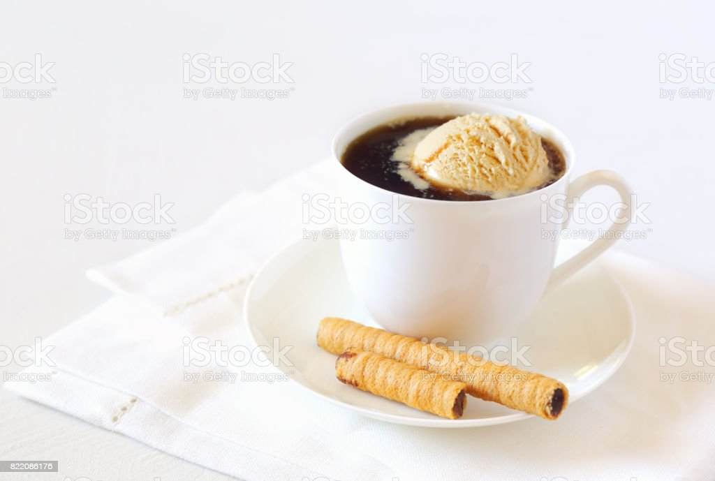 Cup of black coffee with ice cream and chocolate stick stock photo
