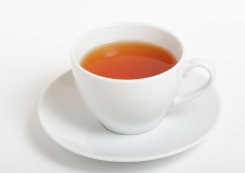 Cup of black tea on white background