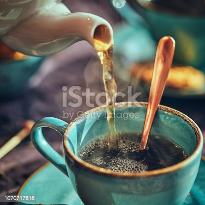 Cup of Black Tea Served with Biscuits