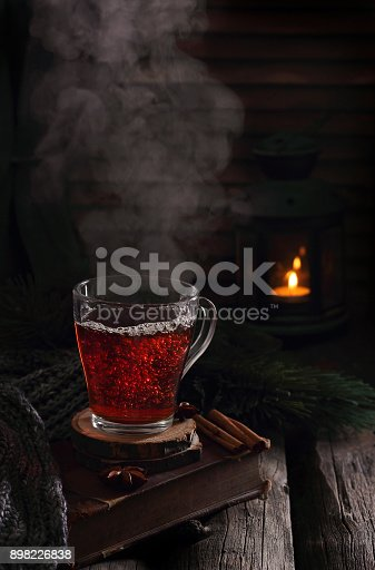 istock cup of boiling black tea in winter decorations 898226838