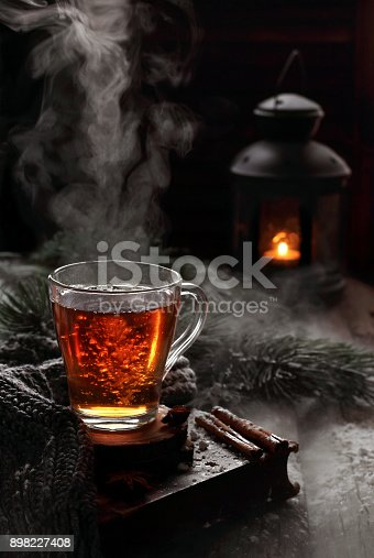 istock cup of boiling black tea in winter decorations 898227408